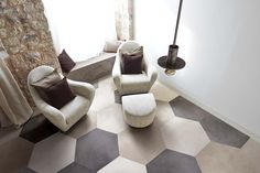 Interesting sizes, rich wood colour and crative tie laying characterise the concrete and wood effect porcelain tiles Visions di Rex. Mix the ceramic wood and the concrete for multiple design ideas.
