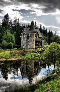 Gatehouse at the start of the two mile driveway of the Ardverikie Castle.  (Love the reflection in the water!)