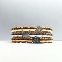 Gold bangles by Katramopoulos