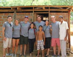 The Giveback Homes team stand proudly in front of the first home built for Pedro and his family. www.givebackhomes.com