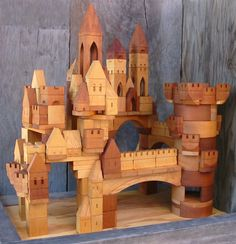 handmade toys This stunning, hand crafted in the USA, 200 piece Castle Building Block Set is a combination of 3 The Village Blocksmith Wooden Block Sets: The Village Blocksmith's 133 Pie Woodworking Toys, Woodworking Projects, Youtube Woodworking, Woodworking Magazine, Wooden Toy Castle, Bg Design, Handmade Wooden Toys, Kids Wood, Wooden Blocks