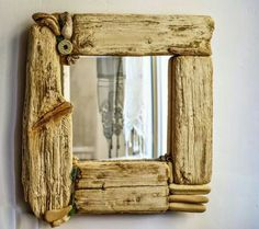 Assemblage mirror with driftwood.