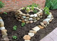 How To Create A Small Vegetable Garden Using A Garden Spiral - Create an architecturally beautiful stone garden spiral for small space gardens.