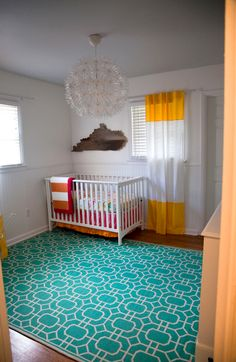 This fab turquoise rug from @Target makes such an impact in this sweet nursery!