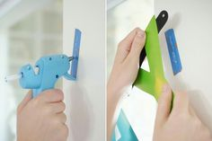 Put painter's tape on the wall.  Apply hot glue and attach the lightweight item. When finished, pull off painter's tape. Voila