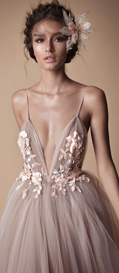 Delicate spaghetti straps, soft, pleated swathes of tulle and floral adornments - @berta evening collection