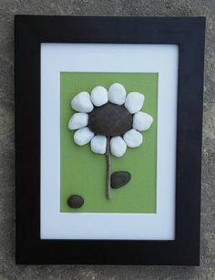 """Pebble Art Flower set on a green background inside white matting in a 6x8 """"open"""" dark brown frame by CrawfordBunch on Etsy"""