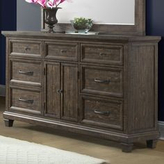The charming Hysham dresser is the perfect addition to any bedroom. This piece features hidden drawers to keep your precious items safe and out of sight. The rich woodgrain finish of this attractive dresser adds to its rustic appeal.