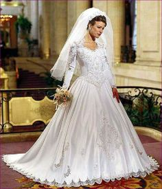This is the classic silhouette of a 1990s bride. Queen Anne neckline, basque waist, long sleeves, cutwork lace. Gorgeous!