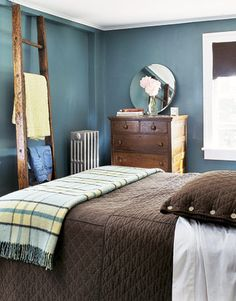 Blue-Green Bedroom Deep blue-green walls are offset by chocolate brown bedding and a rich wood dresser and ladder. Bedroom Design Ideas – Guide to Bedroom Design - Country Living - good colors for masculine room Brandon's room colors for sure Blue Green Bedrooms, Bedroom Green, Bedroom Colors, Master Bedroom, Brown Bedrooms, Kids Bedroom, Master Bath, Ikea Bedroom Furniture, Bedroom Decor