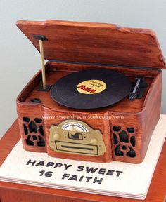 Tutorial for a vintage-looking record player cake that actually spins a sugar record. Step-by-step photos, detailed instructions and video.