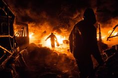 Kiev, Ukraine: Anti-government protesters create a barricade of burning tyres during clashes with riot police.