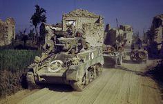 "U.S. Light Tank M3 ""Stuart"" passes through the ruined Italian village."