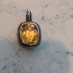 Beautiful citrine and silver enhancer Large, beautifully faceted citrine stone set in Sterling silver with rope design along the edge. Good size vail- most chains will fit thru. Gorgeous stone!!! Jewelry
