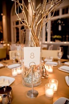 Branch centerpiece- could go out into the woods and get twigs/branches & spray paint them silver/glitter! by jodi