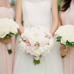 White and Blush Bouquets of Peonies and Ranunculuses and roses!  SOO PRETTY  Or you could use orange or peach roses instead of blush! :)