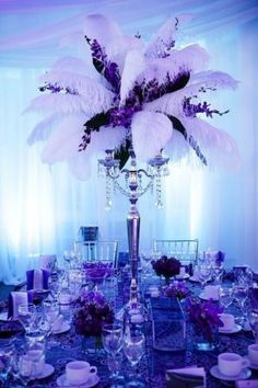 Royal blue hues reminiscent and bright purple are the perfect color combination for anyone interested in a peacock-inspired quinceanera.