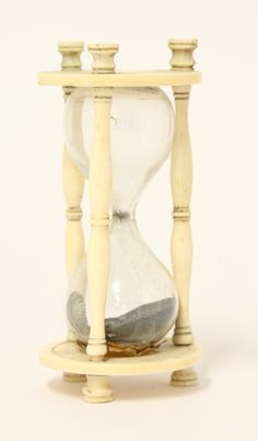Ivory Egg Timer (18th/19th.century) glass jar within turned supports and disc shaped terminals (9cm £150-200) 9th September 2014
