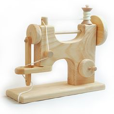 Wooden Toy Sewing Machine for kids is made of unfinished pine in the USA. Turn the hand wheel and watch the needle bob up and down!