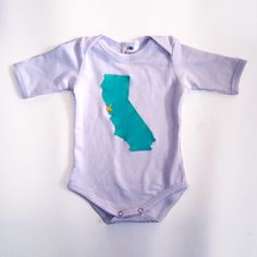 Introducing the Glammic™ onesie! Limited Edition, in white, with a hand cut & sewn California applique.  The star represents San Francisco, where our clothes are made and customized! $35