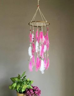 Check out this item in my Etsy shop https://www.etsy.com/uk/listing/499996863/pink-dream-catcher-mobile-pink-feather