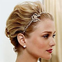 short sleeked back prom hairstyle with a headband
