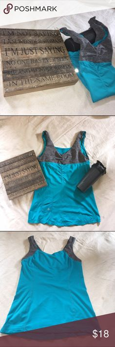 Lulu Lemon 🍋 Teal Tank Top Lululemon Tank Top Teal (the pics make it look more on the blue side) and heather grey. This is one of their first designs, notice the IPod pocket on the front. Worn only a few times and then I lost weight. It was one of my first workout clothing splurges, and I just haven't wanted to part with it...but the time has come. From armpit to bottom seam measures 17 inches. Across bust measures 14-1/2 inches. Fabric: Light Luon, and Lycra. lululemon Tops Tank Tops