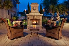 A beautiful outdoor space enhanced with a fireplace can be enjoyed long into the fall and winter months! #Belgard #OutdoorSpaces #Patios
