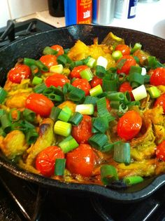 Tumeric chicken with scallions and tomatoes