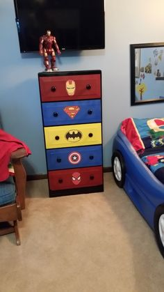 Superhero dresser.. weekend project...  Grandmas  old dresser reworked for our special little boys...