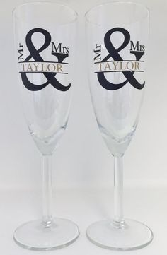 This is listing is for 2 Personalized Champagne Glasses  Beautiful champagne glasses for the Bride and Groom!  -Designs are made with high quality vinyl cut with a professional vinyl plotter. ----------------------------------------------------------------------------  --HOW TO PLACE YOUR ORDER— 1. Wedding Glasses, Champagne Glasses, Wedding Favour Jars, Vinyl Cutting, Couple Gifts, Mr Mrs, Personalized Wedding, Bridal Shower, Groom