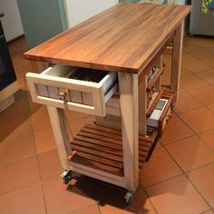 Dimensions for this mobile kitchen trolley are 600w x 1200l x 900h. The wood accents and butchers-block top are in African Mahogany. The framework is made from pine with the centre column from MDF and the drawers from melamine.