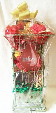 Matisse Chocolatier - Gourmet Chocolate Filled Corporate Holiday Gift Basket Umbrella Stand, $100.00 (http://www.getfreshchocolate.com/gourmet-chocolate-filled-corporate-holiday-gift-basket-umbrella-stand/)