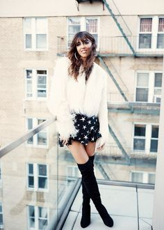 Makeup Artist Violette's Polly Maggoo Halloween Look: Black and White Hoop Earrings, Black Dress with White Stars, White Fur Jacket, Knee High Black Boots | http://coveteur.com