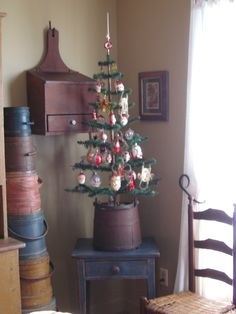Feather tree with vintage ornaments - a little too primative for my decorating tastes, but I like the idea of the upside down bucket