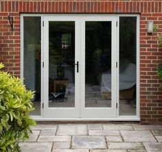 Patio doors in Farrow and Ball Off white.  Constructed using Accoya timber, and Carlisle Brass hardware