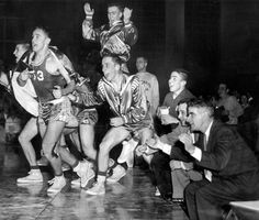 "The Omaha Benson bench explodes on March 7, 1957, when a victory over Fremont in the North Omaha Class AA Regional Basketball Tournament was cemented. The Bunnies, who had won two of 16 games going into the matchup, won 53-40 over Fremont, which was No. 1 in the state. ""Benson's crafty coach"" Scotty Orcutt is at right. THE WORLD-HERALD"