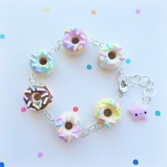 This listing is for one Charm bracelet 17cm in length + 3.5cm (extend chain)  The charms are made out of polymer clay and are attached to the