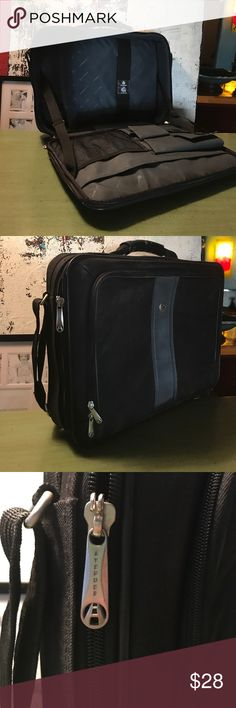 """Avenues laptop briefcase black bag new! Awesome black laptop bag, in new condition without tags. Never used. Several pockets for storage and organization. Will fit up with 17"""" laptop safely. Shoulder carry strap and handle. Several easy access pockets on outside for quick access, while having safe storage with zippers inside. awesome laptop case! Avenue Bags"""