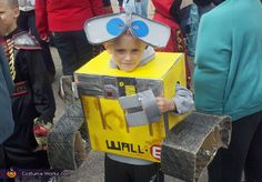 Brandy: My son is wearing the costume. We made it together and used materials laying around house. These included aluminum foil cardboard boxes and duct tape. This idea came from the...