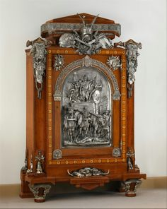 Cabinet Designed by Jean Brandely (French, active 1855–67)  Date: 1867 Medium: Oak veneered with cedar, walnut, ebony and ivory; silvered-bronze mounts.