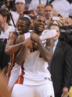 LeBron James (6) celebrates with Dwyane Wade (3) after