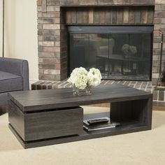 $330 - allmodern.com - The Rectangular Mod Rotatable Coffee Table offers a clear late 60's vibe to any room it is placed in. With a rotating top and an extra storage drawer underneath this table is multifunctional and unique. Make a statement in your home with the Rectangular Mod Rotatable Table.