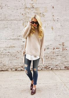Atlantic Pacific in a casual loose knit sweater, ripped skinny jeans, and shiny loafers