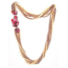 Goossens for Chanel Multi-strand Pearl & Pâte de verre Camellia Necklace 1970s | From a unique collection of vintage multi-strand necklaces at https://www.1stdibs.com/jewelry/necklaces/multi-strand-necklaces/