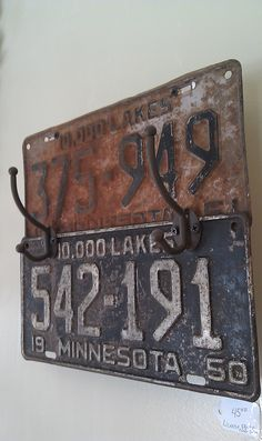 Rusty vintage license plates made into a coat rack