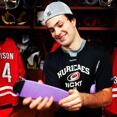 Carolina Hurricanes' Ryan Murphy puts lavender tape on his stick for #HockeyFightsCancer Awareness Night.