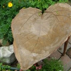 It's really easy to make a decorative and unique lightweight leaf shaped concrete bird bath for your backyard garden. All you need are a pile of clean sand, a bucket of water, rubber gloves, plastic trash bags, a bag of acrylic concrete patch mix,...
