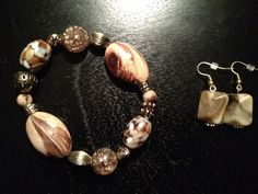Browns and golds by thefalconandtheraven on Etsy, $26.99 Also includes necklace