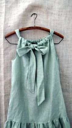 Ribbon tank or longer for a cute summer dress. Cut two rectangles (can be more exact and cut curves near top for arm holes). Sew a tube on top of both. Pull ribbon/fabric through and knot. Sew sides up. Maybe a couple layers, or lace instead of ruffles at the bottom? Hmmm